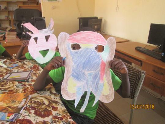 Making masks in summer reading camp