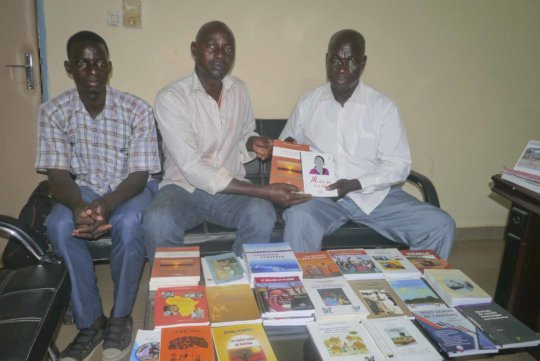 Books presented to library of Koumbia