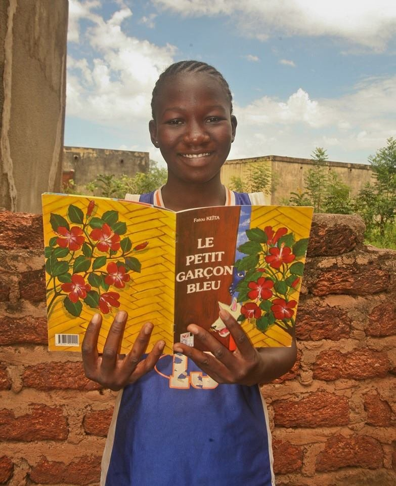 Smiling reader of Fatou Keita, Feb 2016