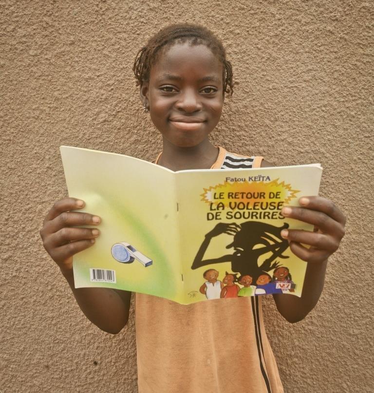 Reading Fatou Keita outside FAVL library