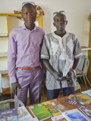 Rouko officials with donated books