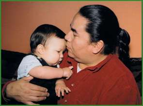 "Aboriginal Dad and Baby ~ ""Love grows brains"""
