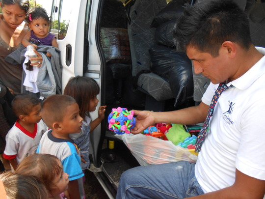 Distributing toys for the children