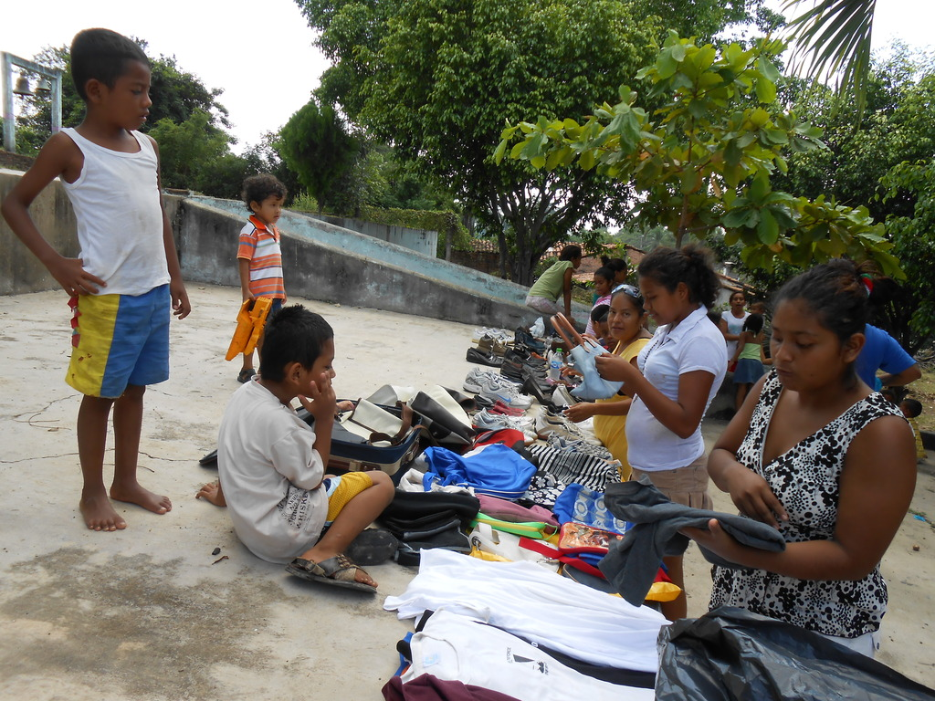 Women and children choosing clothes