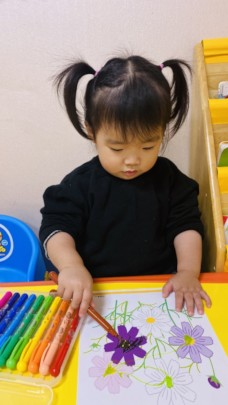 Minnie coloring at school.
