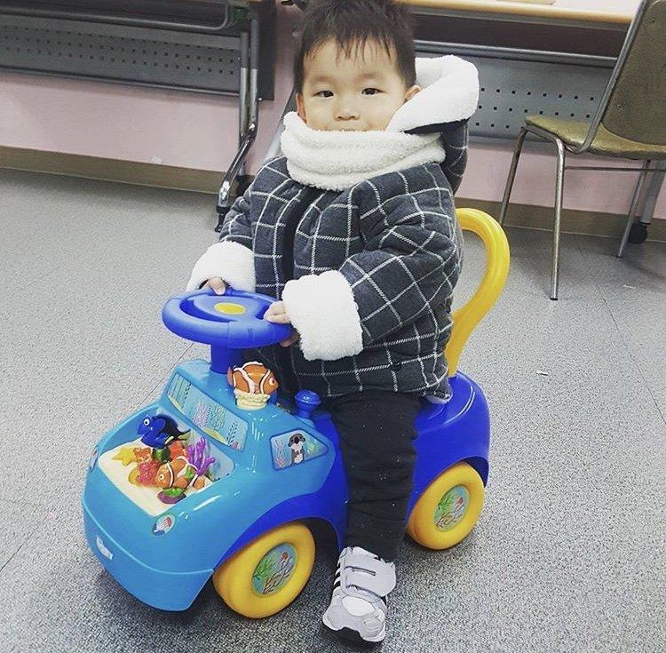 HyungJun enjoying his new toy car from Christmas