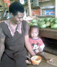 Sarah, a mother of six, feeds her child Ekitobeero