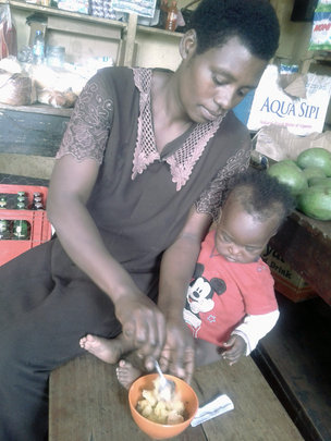 Sarah feeds her child Ekitobeero in rural Uganda