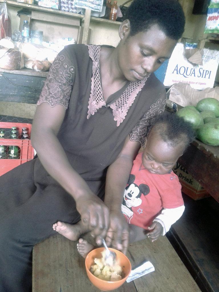 Sarah feeds her child Ekitobeero in rural Uganda