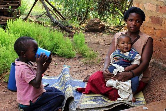 Child eating Ekitobeero in Uganda