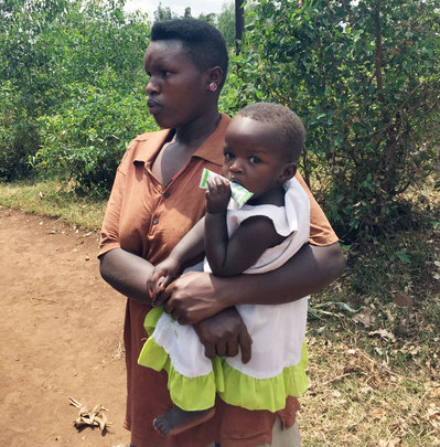 Little girl from Uganda with her mother
