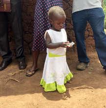 Little girl eating Ekitobeero and getting healthy!