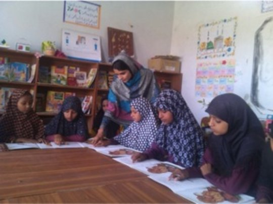 Riaz teaching at a school she once attended