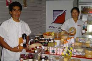 Workers pose with products