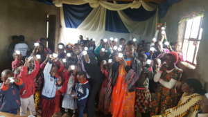 Hilonga with children with their solar lanterns