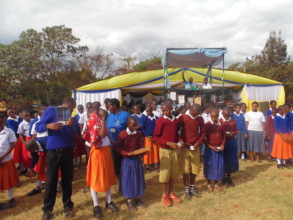Gongali students turning ON the Solar Lanterns