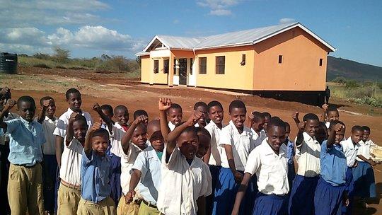 Gongali Children beside their new school