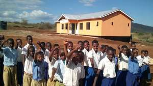 Gongali Children beside their new school