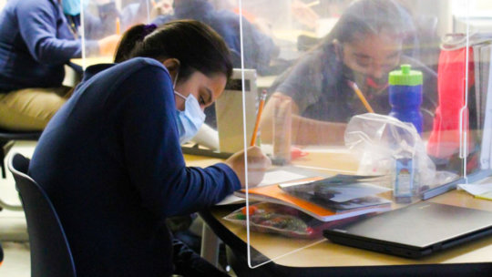 Masks and plexiglass are now standard in class