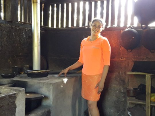Petronila from San Roque shows off her new stove