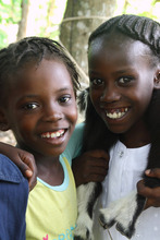 Youslie (left) and her friend Wichide at school