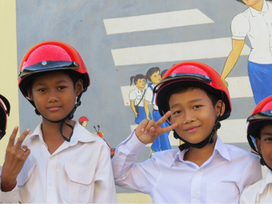 Students at a road safety mural in Sdao Konleng