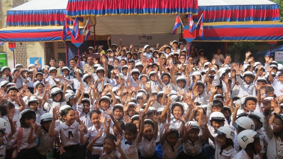 Students are happy to receive helmets