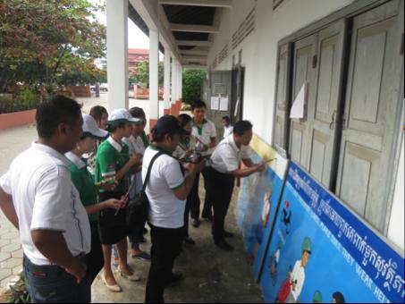 Volunteers paint a mural at a school in Siem Reap.