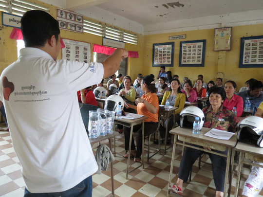Parents learn about road safety and helmet use