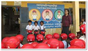 Students demonstrate how to wear helmets correctly