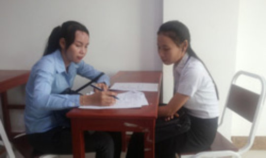 A university student in Cambodia takes a survey.