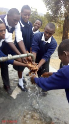 Students enjoying the flowing water.
