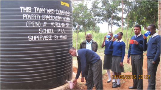 student drawing drinking water from new tank