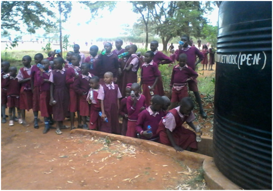 Children queue to draw water from water tank