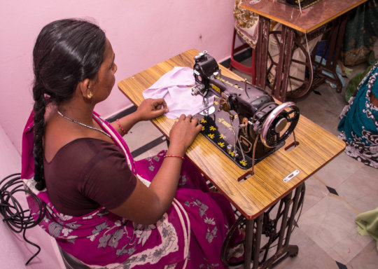 Poor woman learning tailoring training for income