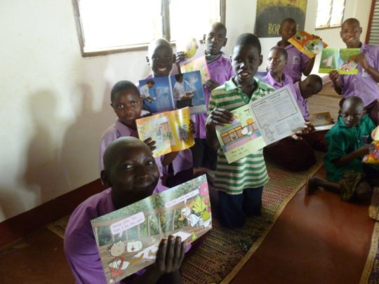 Children with books in Sumbrungu library, Ghana