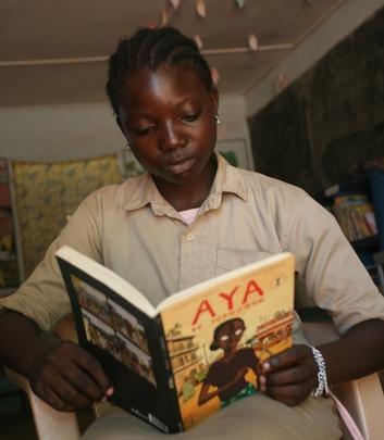 Girl reading popular Ivorian series