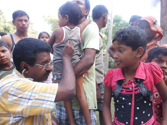 IMC doctor examining a child