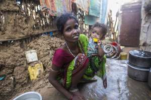 Santoshi and Sunderi in the wreckage of their home
