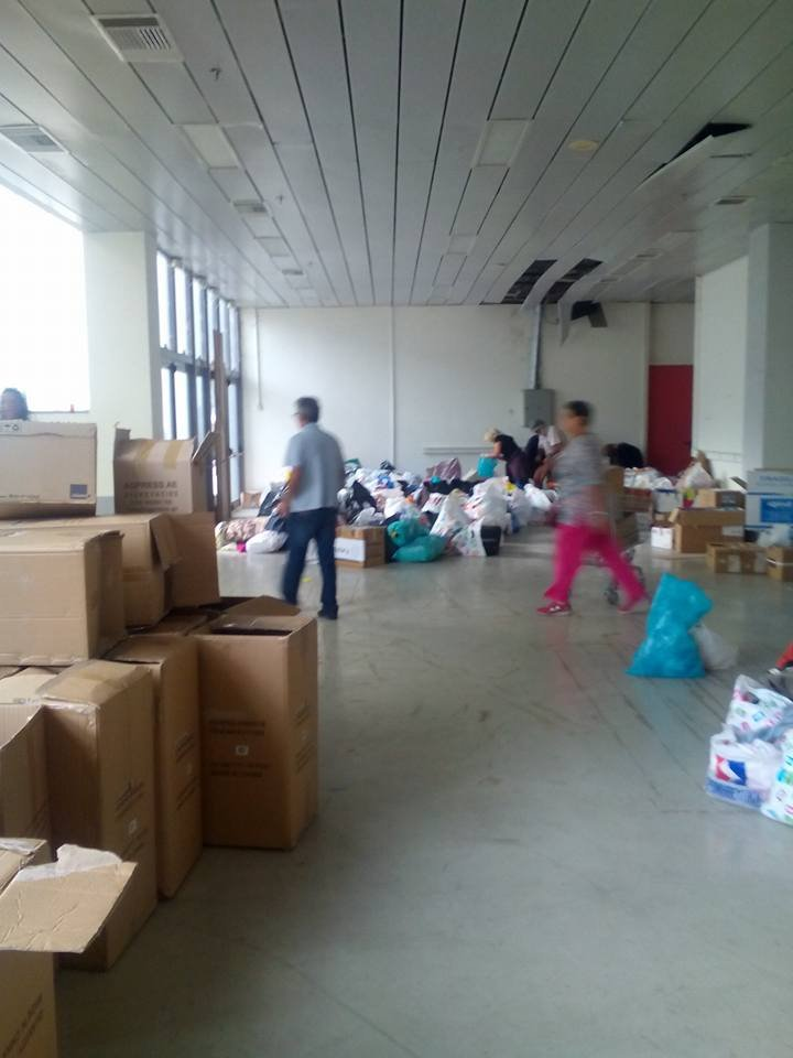 sorting out the goods we bring for families
