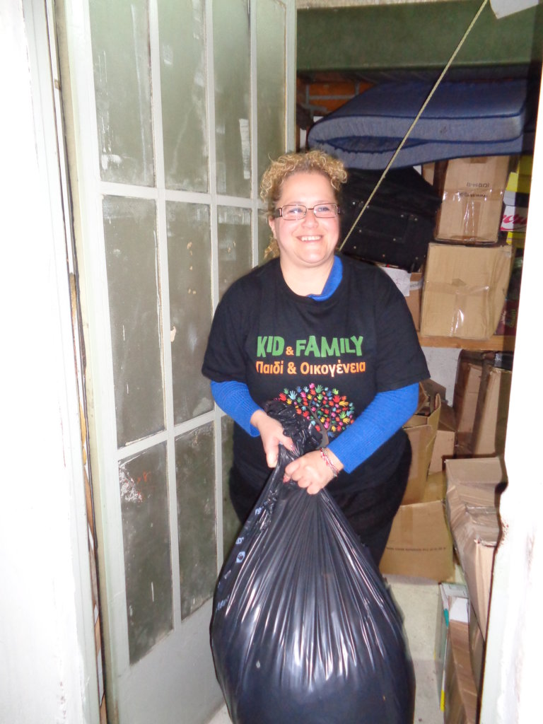 CARRYING CLOTHES FROM OUR WAREHOUSE TO FAMILIES