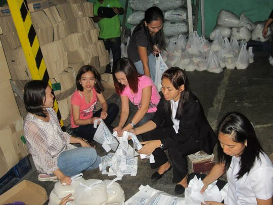 Volunteers pack food for AAI-IPI typhoon relief