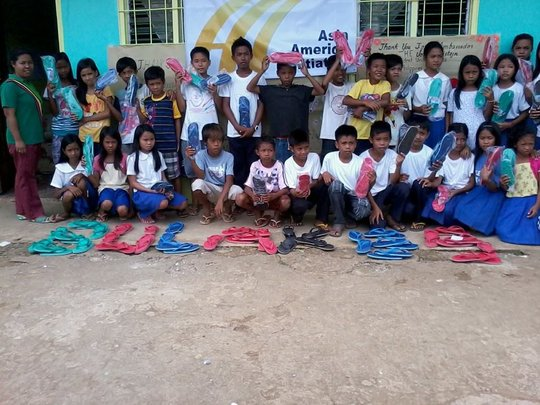 Providing rubber sandals to every school child