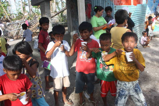 Happy children eat a full meal 1 month after storm
