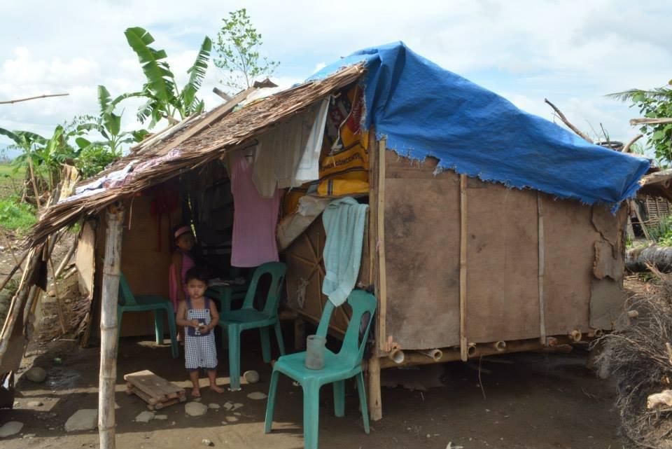 Malnourished child in makeshift shelter