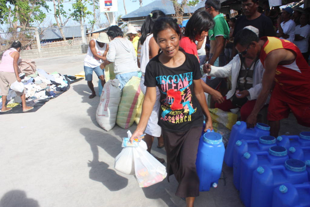parents pick up donated food, water and clothing
