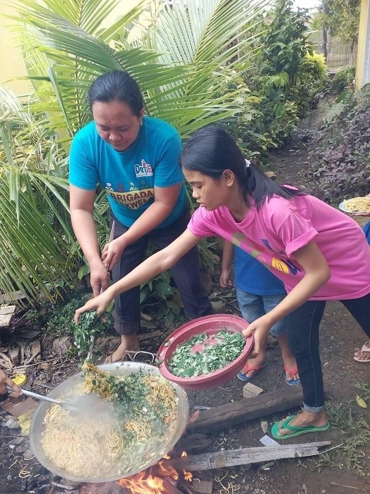 a 6th grade pupil helps Mom prepare school lunch