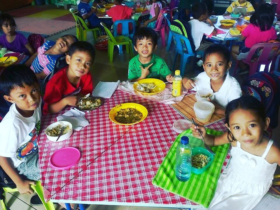 A happy meal at Angub Elementary School