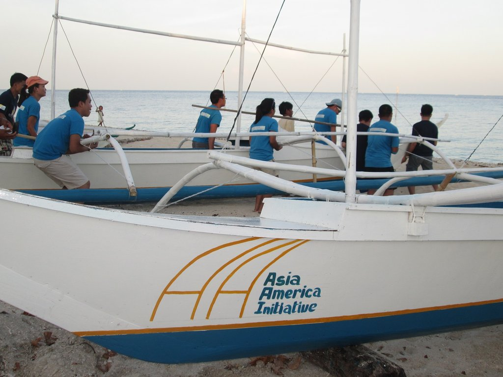 AAI youth volunteers carrying new boats to sea