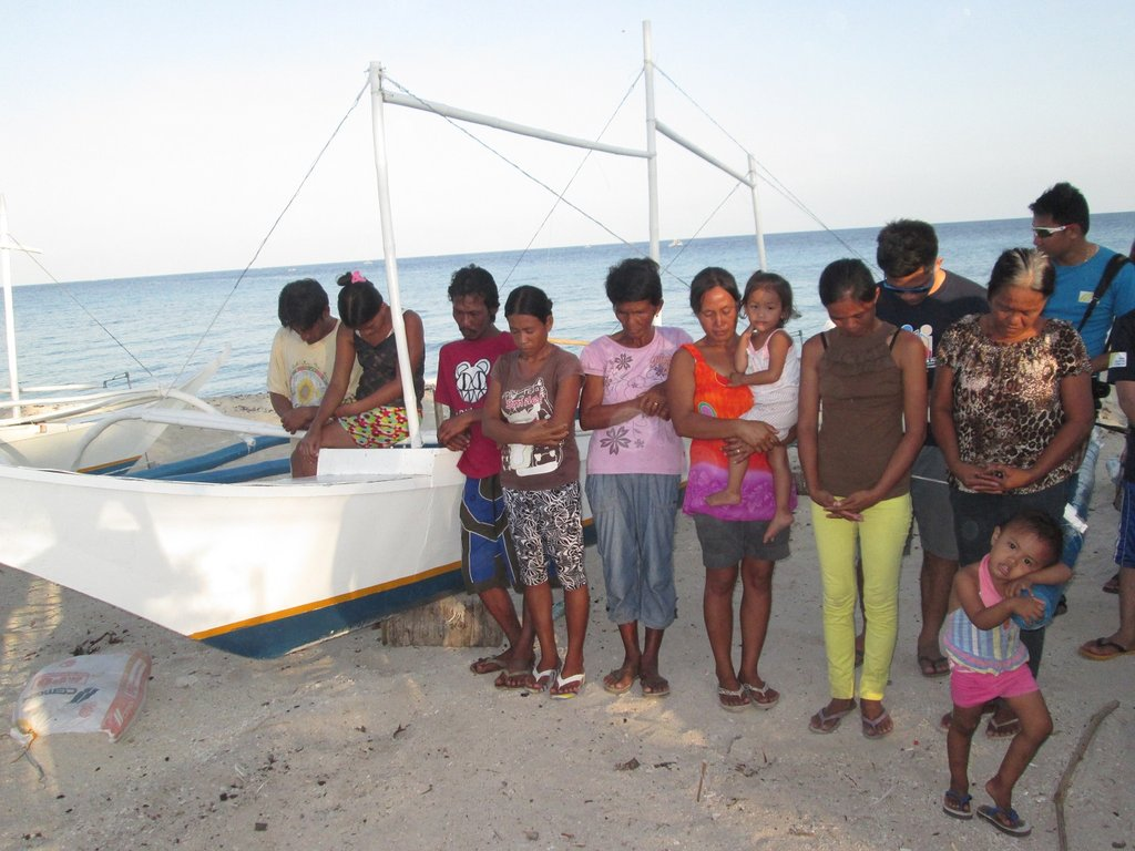 Baliguian fisher folk thank God for life and boats